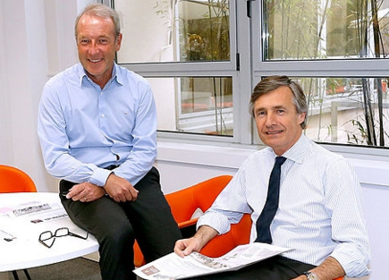 CEO of L'Opinion, Christophe Chenut and President, Nicolas Beytout seated in L'Opinion's Parisian newsroom. [photo courtesy of Getty Images]